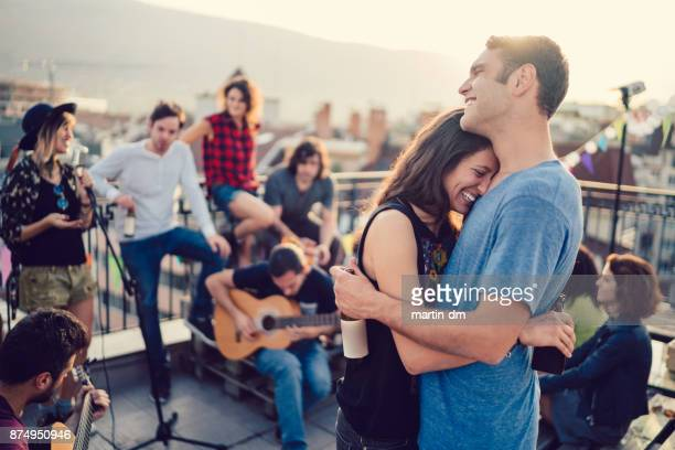 Teenagers on rooftop party