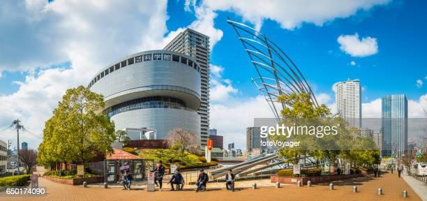 Teenagers outside the National Museum of Art Osaka panorama Japan