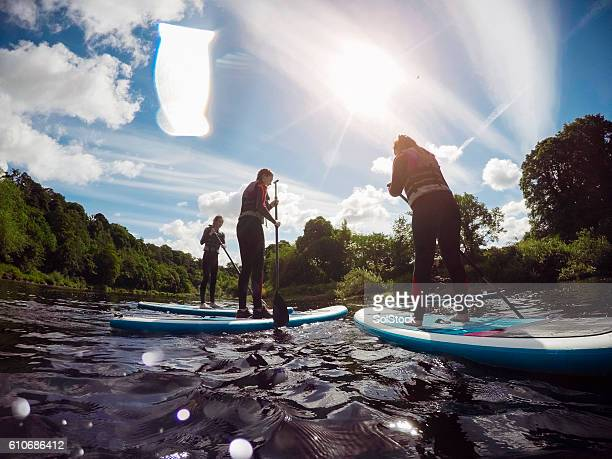 Teenagers Paddleboarding