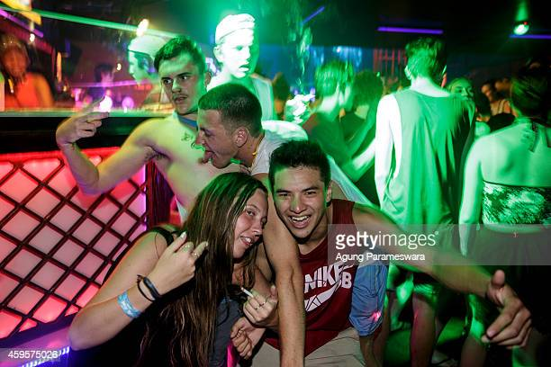 Teenagers party in a nightclub during Australian 'schoolies' celebrations on November 26 2014 in Kuta Bali Indonesia This year around 6000 students...