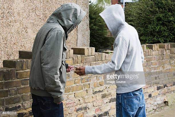 teenagers passing drugs - crime or recreational drug or prison or legal trial bildbanksfoton och bilder