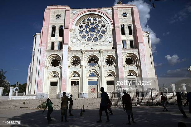Teenagers play soccer near a cathedral destroyed by the earthquake on March 4 2012 in PortauPrince Haiti Two years after the 70 magnitude quake that...