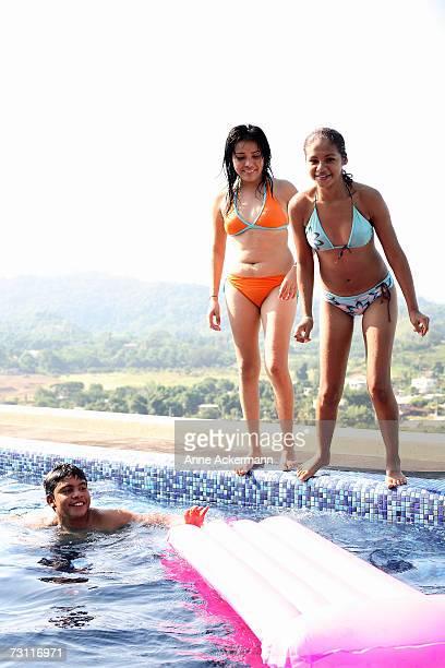 Teenagers (15-19) playing in swimming pool