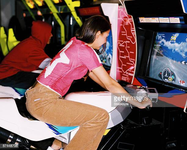 teenagers playing on video game simulations