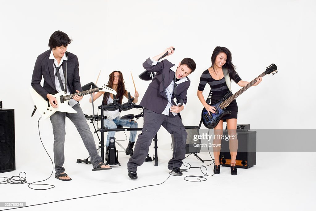 Teenagers playing rock music : Stock Photo