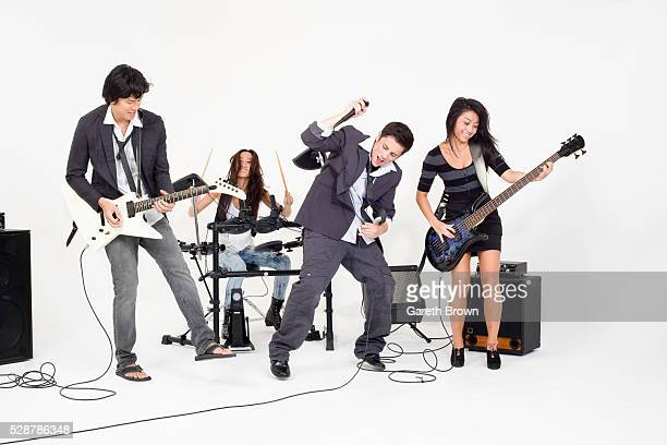 Teenagers playing rock music