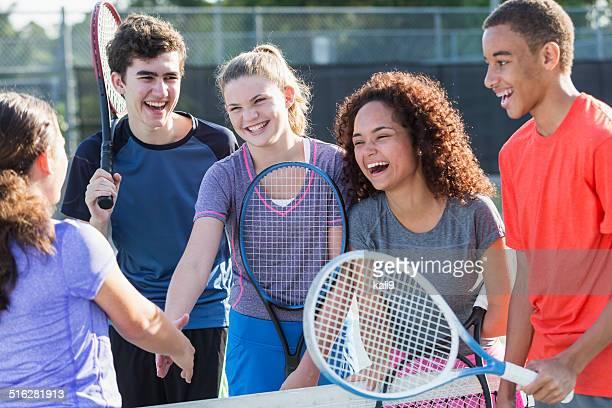 Teenagers playing tennis