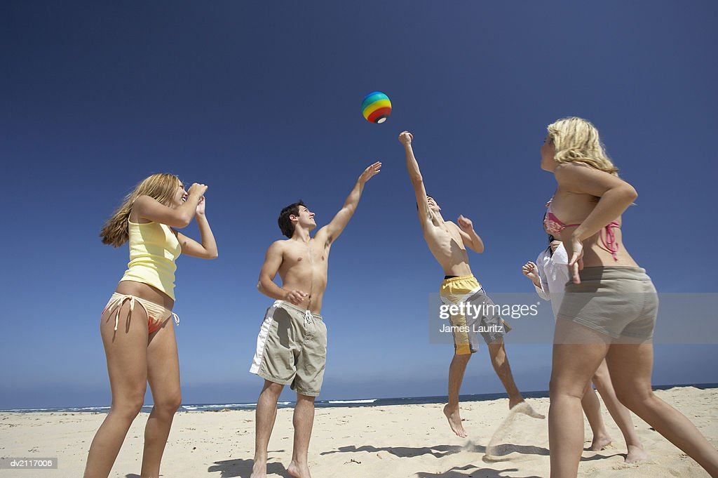 Teenagers Playing with a Ball on a Beach : Stock Photo