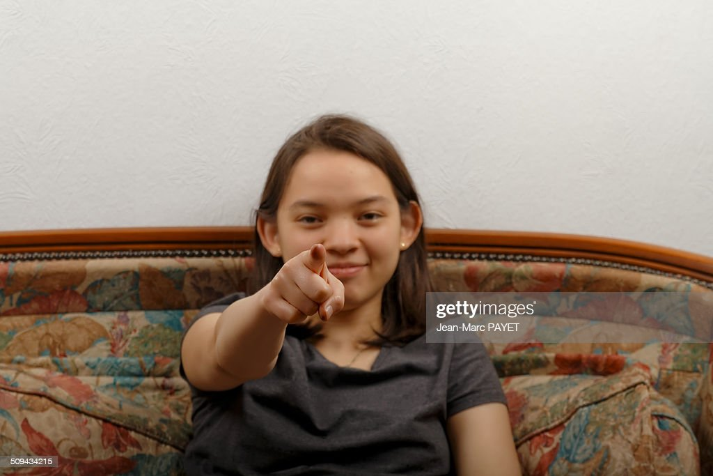 Teenager's portrait showing something of finger : Photo
