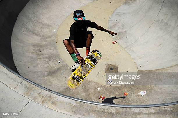 Teenagers practice skatebaord tricks in the skateboard park donated by skateboarder Tony Hawk in Wilson city park community center on July 19 2012 in...