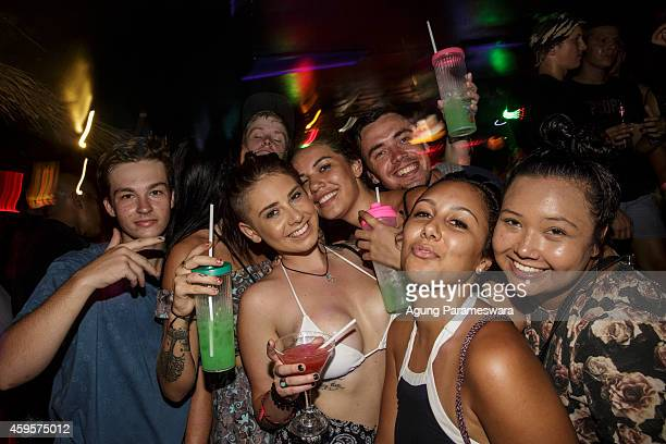 Teenagers raise their drinks in a toast during Australian 'schoolies' celebrations on November 26 2014 in Kuta Bali Indonesia This year around 6000...
