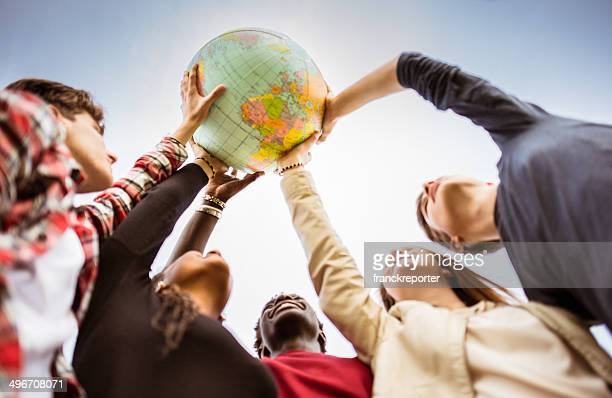 teenagers reaching the world at campus - reaching stock pictures, royalty-free photos & images