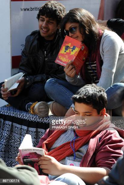 Teenagers read Indian author Chetan Bhagat's novel during DSC Jaipur Literature Festival in Jaipur on January 21 2012 The annual Jaipur festival...