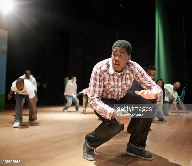 teenagers rehearsing on stage - actor stock pictures, royalty-free photos & images