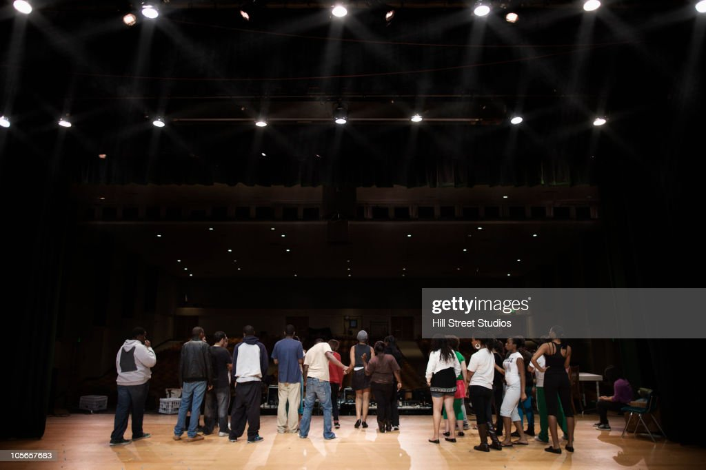 Teenagers rehearsing on stage : Stock Photo