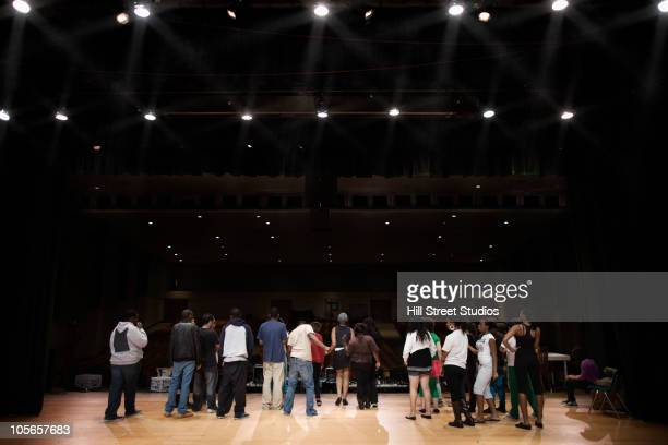 teenagers rehearsing on stage - stage light stock pictures, royalty-free photos & images