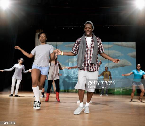 teenagers rehearsing on stage - rehearsal stock pictures, royalty-free photos & images