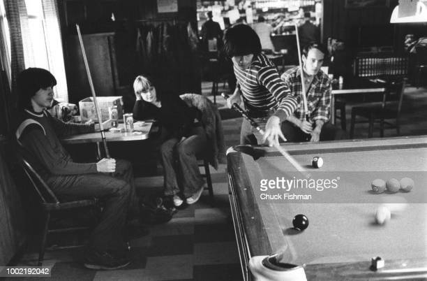 Teenagers shoot pool in a bar in rural New Athens Illinois 1976