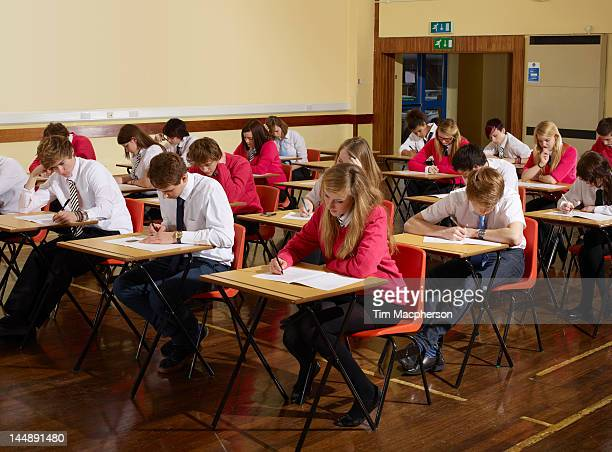 teenagers sitting an exam