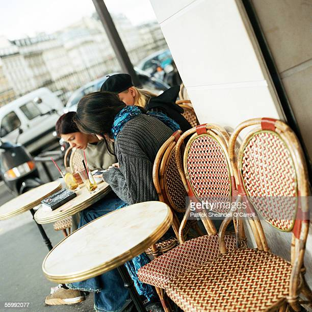 Teenagers sitting at cafe terrace