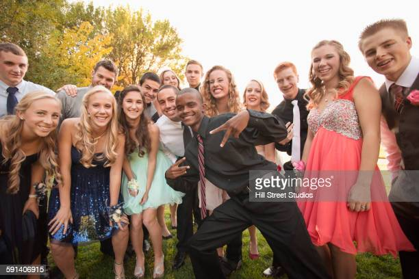 Teenagers smiling before prom