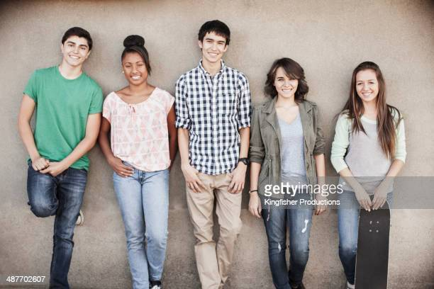 Teenagers smiling together outdoors