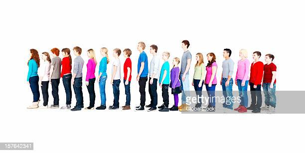 Teenagers standing in a line against white