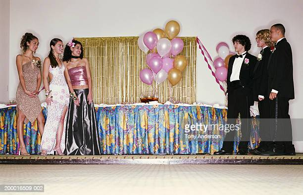 teenagers (16-18) standing near punch bowl at prom - prom stock pictures, royalty-free photos & images