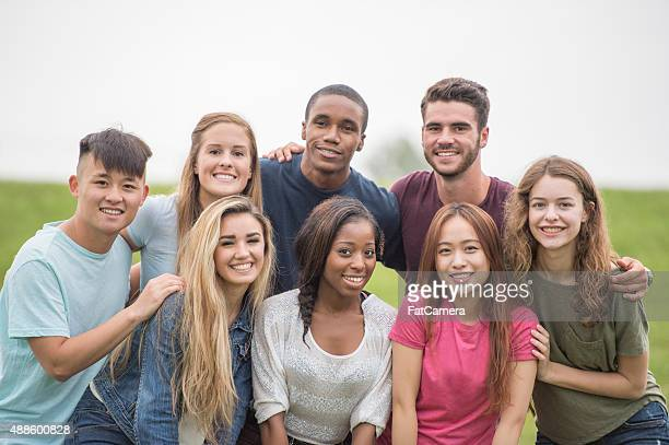 Teenagers Standing Together in a Group Outside
