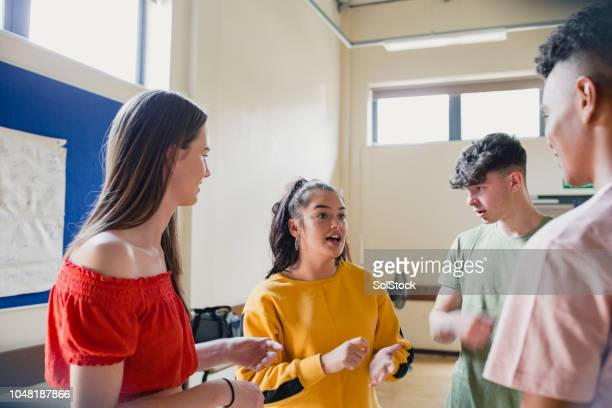 teenagers talking in youth club - childhood stock pictures, royalty-free photos & images