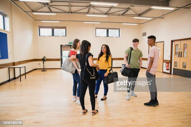 teenagers talking in youth club - community center stock pictures, royalty-free photos & images