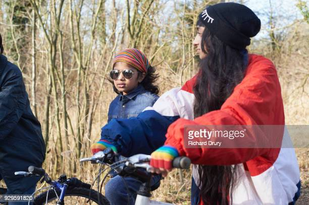 Teenagers talking on cycle track