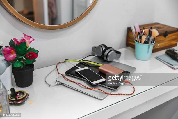 teenager's tech devices charging - headphones stock pictures, royalty-free photos & images