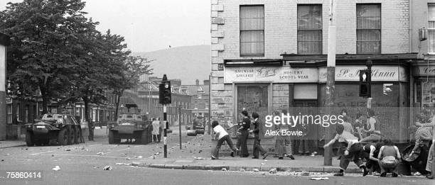 Teenagers throw stones at the British Army during rioting on the republican Falls Road in Belfast 17th September 1976 The heavily fortified...