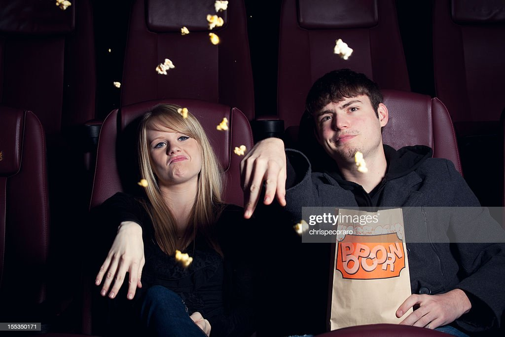 Teenagers Throwing Popcorn at the Movie Screen : Stock Photo