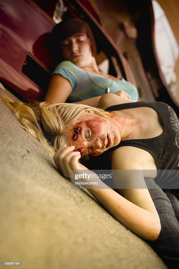 Teenagers Thrown From Fatal Car Accident : Stock Photo