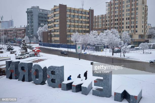 Teenagers walk by the New Born monument during a snowfall as the new US Trump administration reaffirms its support for a stable Kosovo the newest...