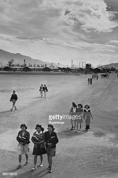 Teenagers walking along street most carrying books Ansel Easton Adams was an American photographer best known for his blackandwhite photographs of...