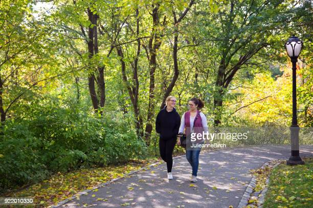 teenagers walking in central park, nyc - parkland stock pictures, royalty-free photos & images