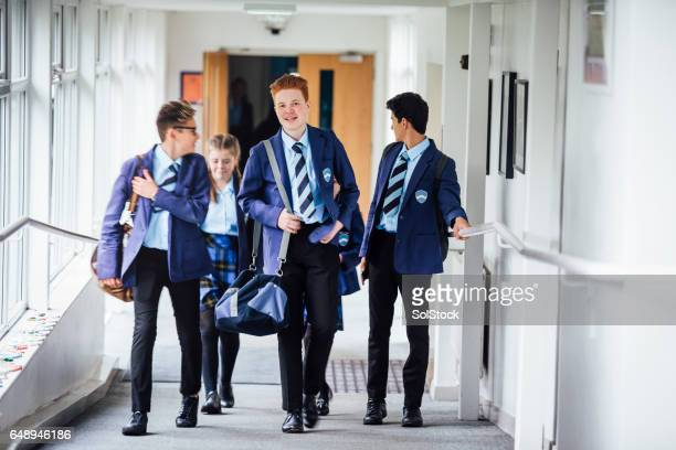 Teenagers Walking to Next Lesson in School