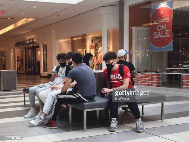 Teenagers wearing face masks to protect from the novel coronavirus at a shopping mall in Toronto Ontario Canada on July 23 2020