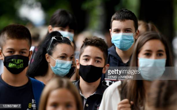 Teenagers wearing protective face masks arrive at school on September 7, 2020 in Zagreb. - School started in Croatia today with the implementation of...