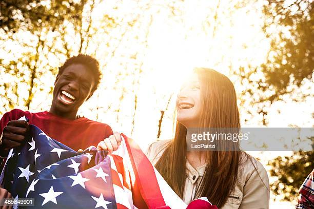 teenagers with usa flag - non western script stock pictures, royalty-free photos & images