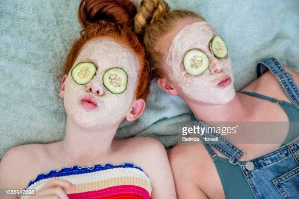 teenages check out their skin for pimples and apply face masks - thisisaustralia stock pictures, royalty-free photos & images