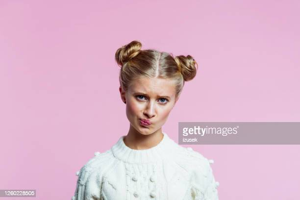 teenege girl grimacing - disappointment stock pictures, royalty-free photos & images