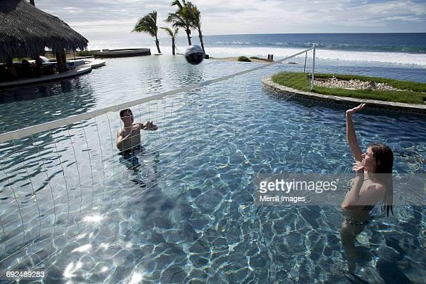 teengirl and boy play volleyball in pool - todos santos mexico fotografías e imágenes de stock