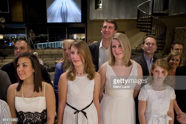 Teens and their parents stand by the altar as the teens prepare to receive rings from their parents during a purity ring ceremony on February 13 2008...