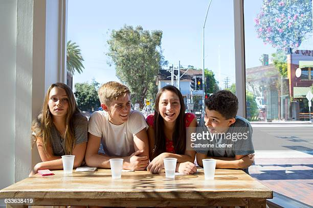 Teens at a bright cafe