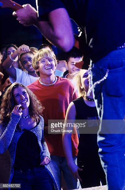 teens at rock concert - classic rock stock pictures, royalty-free photos & images
