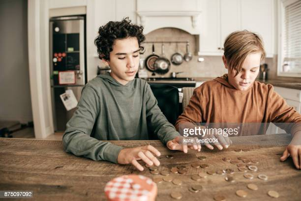 teens counting savings - counting stock pictures, royalty-free photos & images